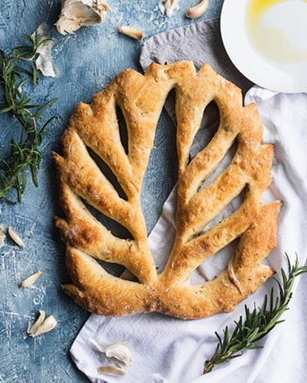 Crusty loaf of leaf-shaped fougasse bread