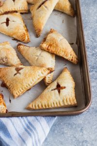 Peach Hand Pies -- Sweet vanilla peach filling folded into a flaky pastry crust, then baked to golden perfection || Good Things Baking Co.