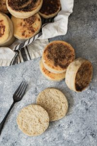 A stack of toasty, fresh sourdough English Muffins