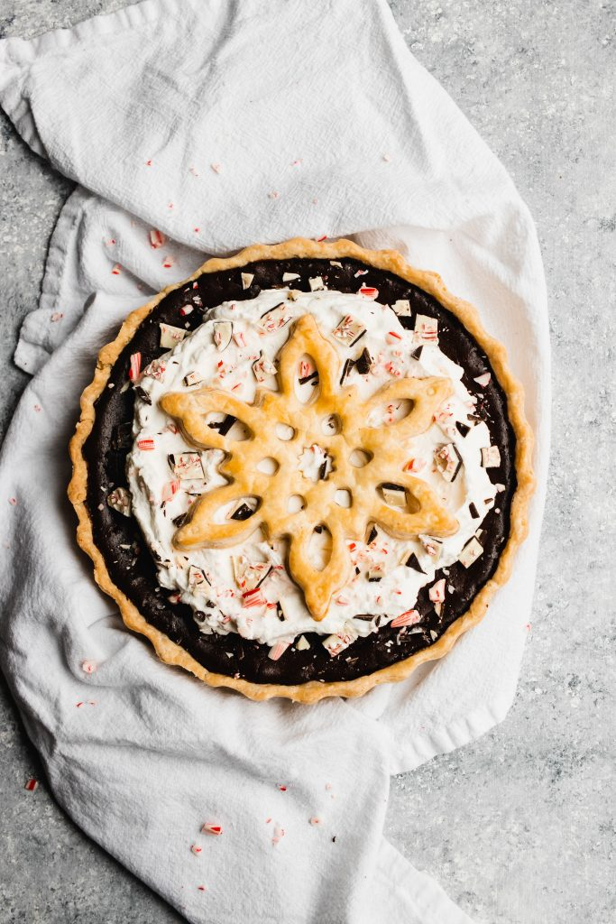 Peppermint Chocolate Pie, topped with whipped cream and a giant crust snowflake