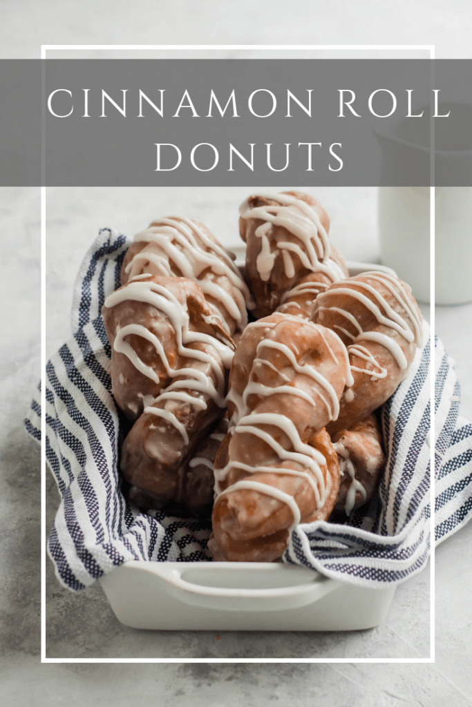Cinnamon Roll Donuts -- Donut Twists in a pan with glaze drizzled over the top.