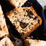 A piece of Chocolate Chunk Snack Cake with a crusty sugar topping.