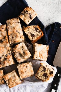 Crusty sugar topped squares of Chocolate Chunk Snack Cake.