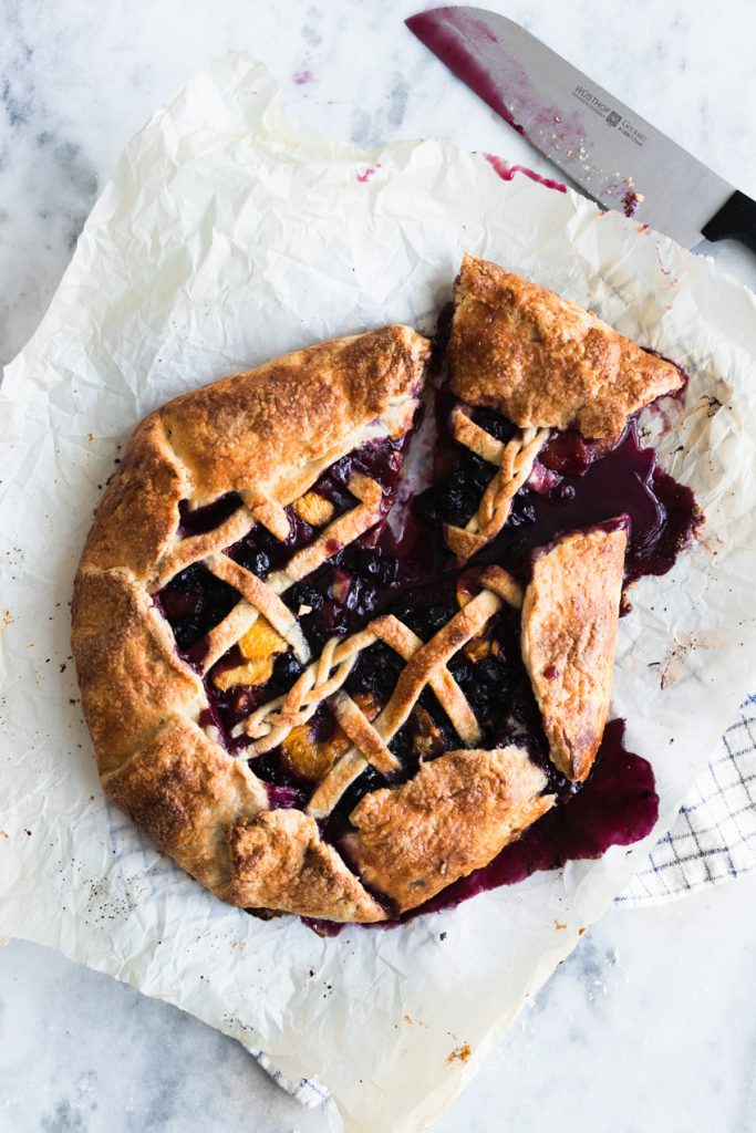 A Slice of Blueberry Peach Galette with a Lattice Top