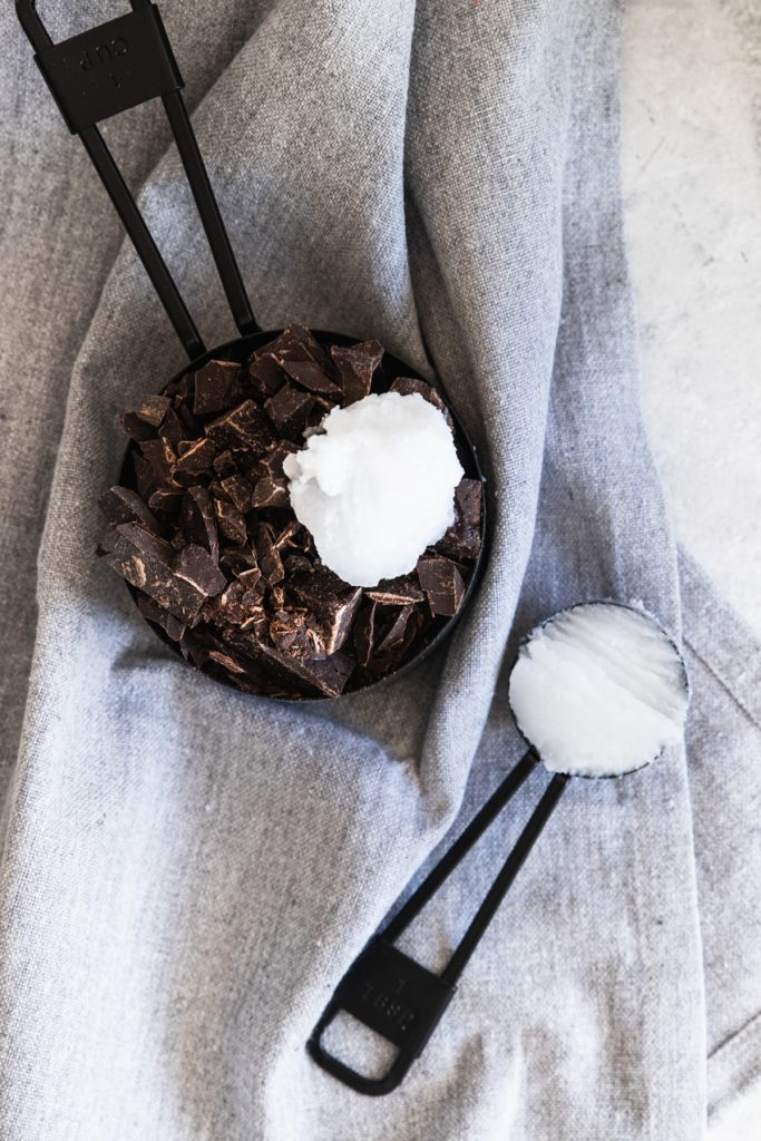Chopped chocolate and coconut oil, the ingredients for Magic Shell ice cream topping