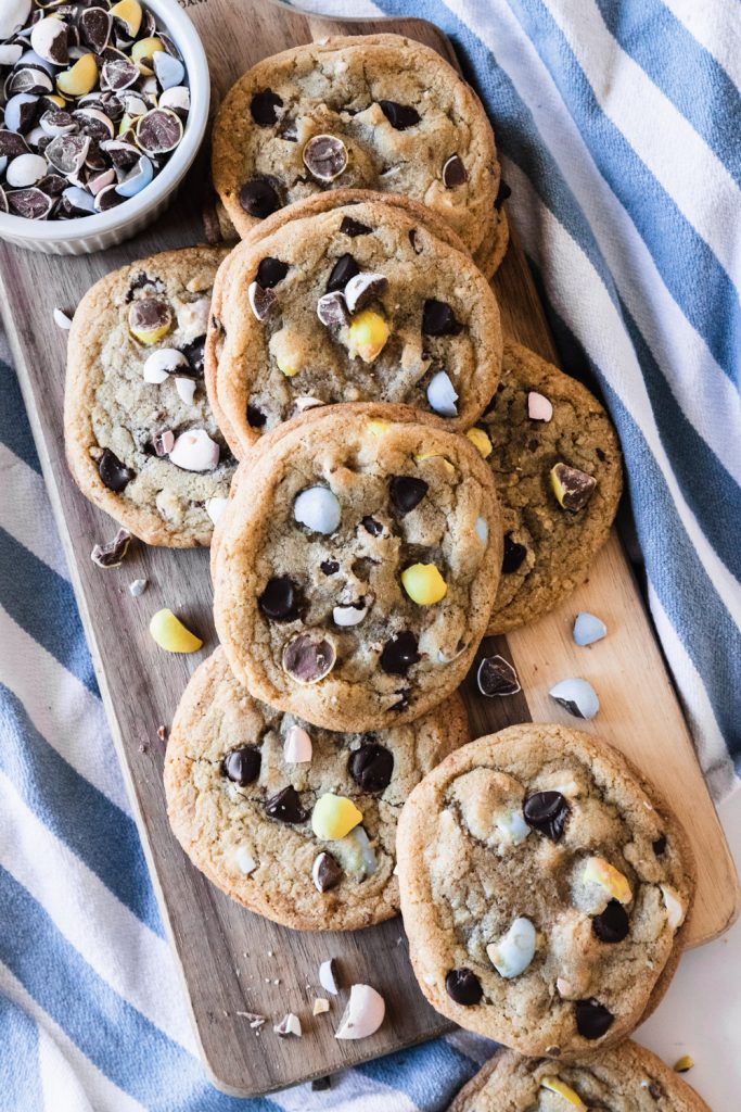 Chocolate Chip Cookies with Cadbury Easter eggs on top.