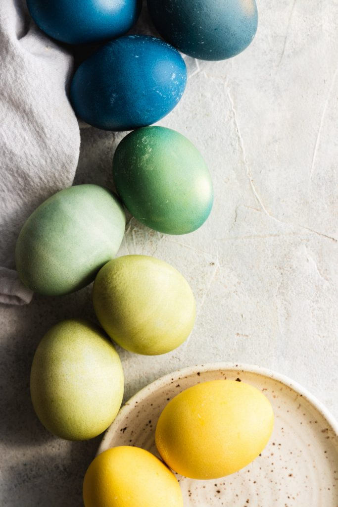 Green Easter eggs dyed naturally with turmeric and red cabbage