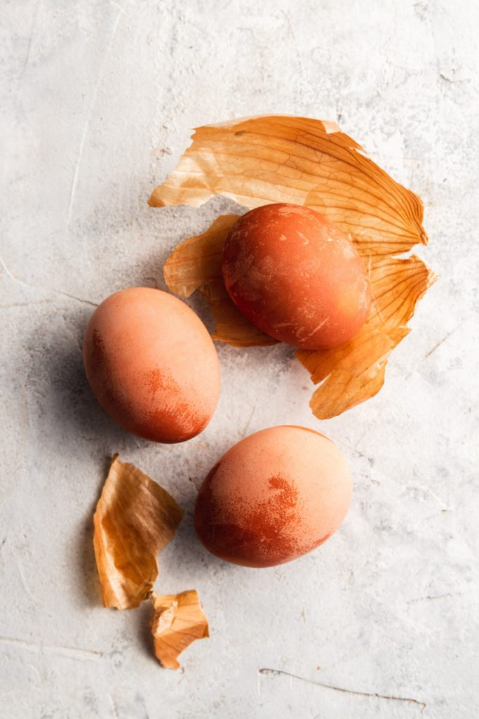 Three orange Easter eggs dyes with yellow onion skins