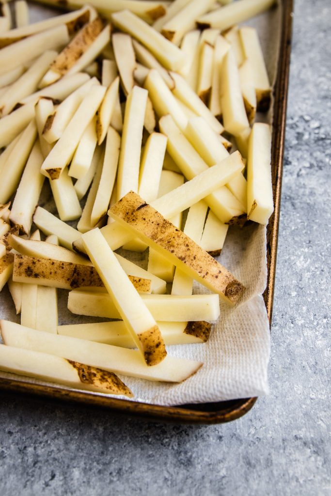 Raw potatoes, cut into matchsticks and ready for frying.