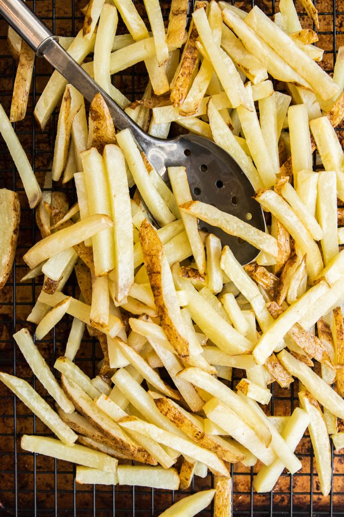 Homemade French Fries after the first fry, ready to be chilled and fried again.