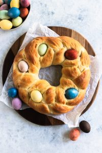 Italian Easter Bread is a braid circle loaf decorated on top with dyed Easter eggs.